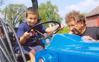 Boy on tractor